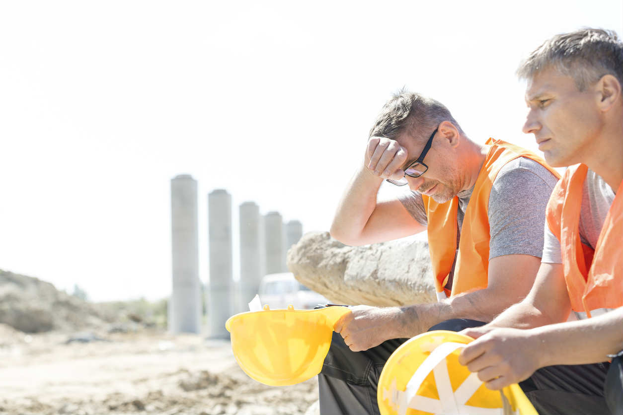 two construction workers in the sun