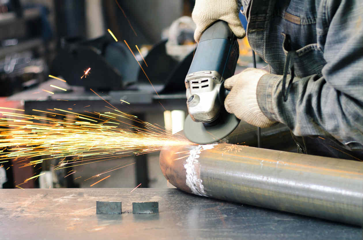 St. Louis worker using angle grinder