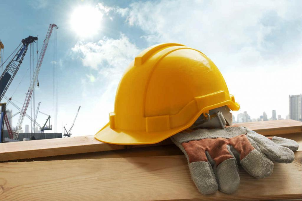 construction worker gloves and helmet