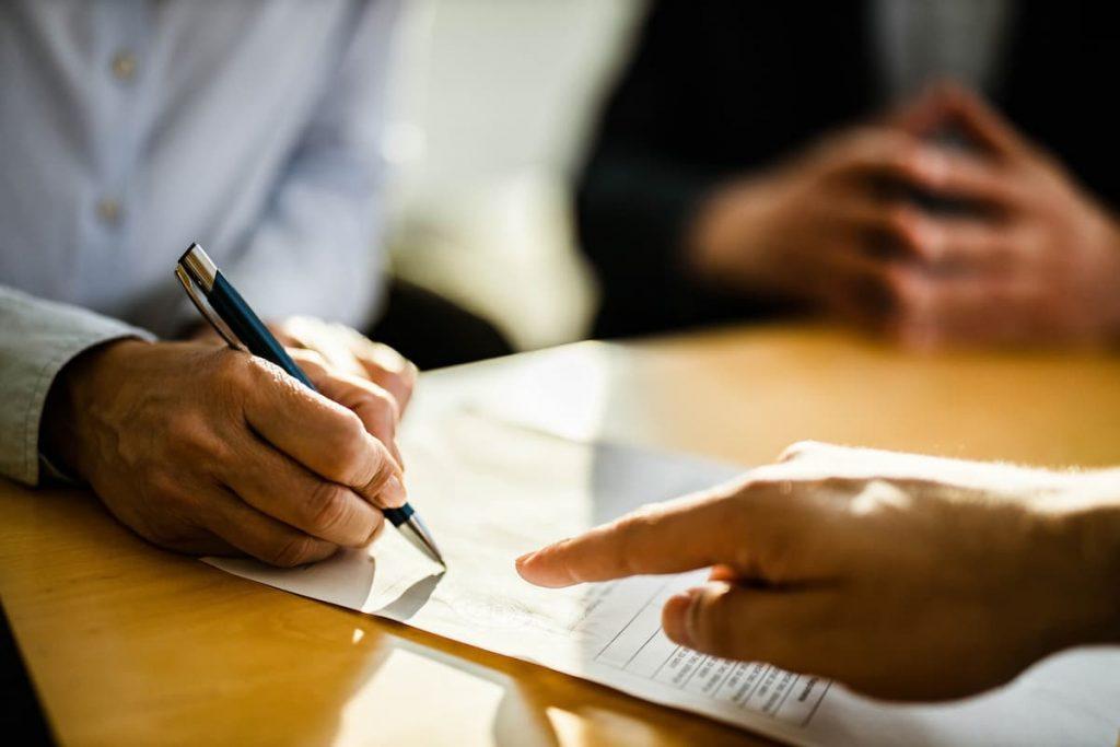 injured worker signing a settlement offer
