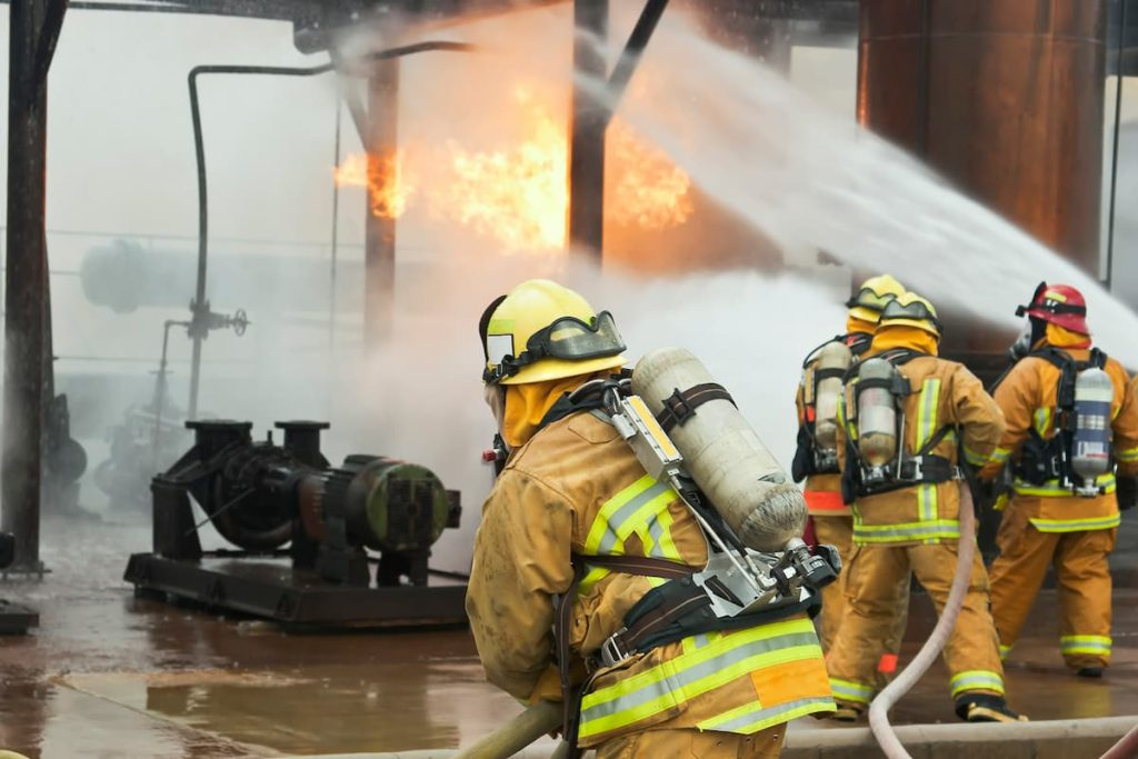 firefighters at the scene of a workplace explosion