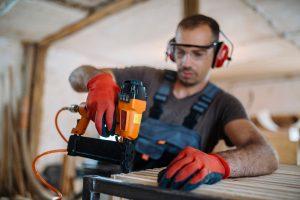 missouri construction worker using a nail gun