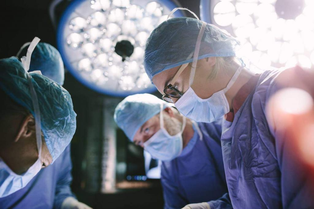 doctors performing surgery after work injury